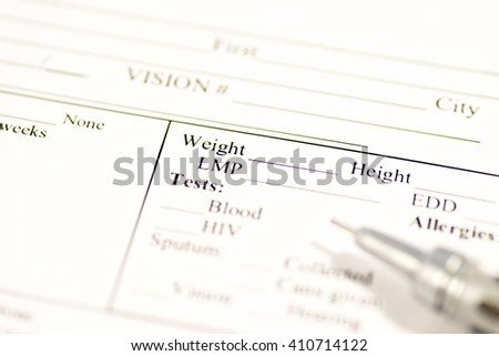Medical record with pen