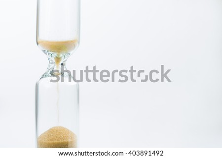 Medical sandglass, almost no sand. Isolated. Concept of time. - stock photo
