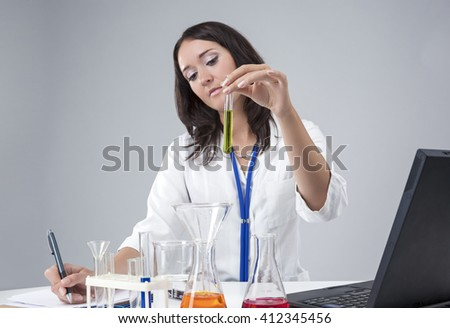 Medical, Science Concepts and Ideas. Caucasian Female Lab Staff Dealing With Laboratory Glassware.Horizontal Image Composition - stock photo