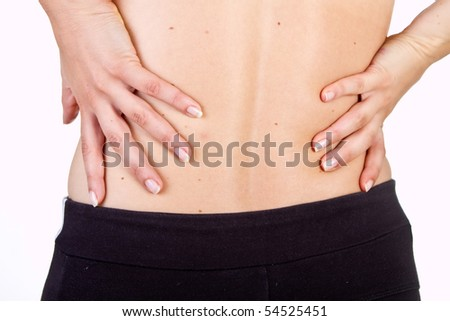 Medical shot showing a woman with pain in her back. Isolated over white. - stock photo