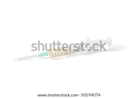 Medical spire on a white background. Disposable syringe for injection