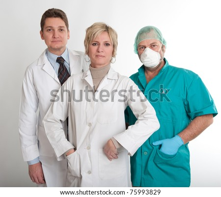 Medical staff team with a surgeon a practitioner and a nurse - stock photo