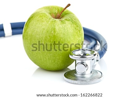 Medical stethoscope and apple isolated on white - stock photo