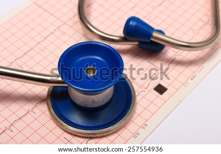 Medical stethoscope and electrocardiogram graph ekg heart rhythm, medicine concept - stock photo