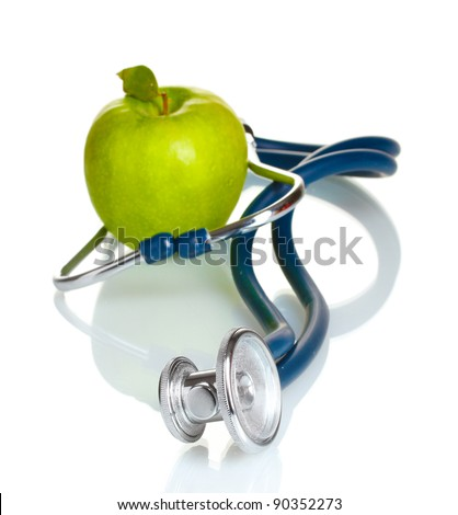 Medical stethoscope and green apple isolated on white - stock photo