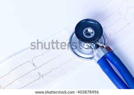 Medical stethoscope, ekg, electrocardiogram on white background. Medicine, health hospital equipment for health care, treatment. Closeup diagnostic instrument, examination device for pulse, heartbeat - stock photo