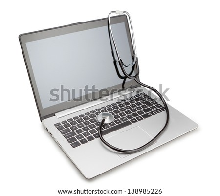 Medical stethoscope on a modern laptop, for the treatment of viruses. Isolated. - stock photo