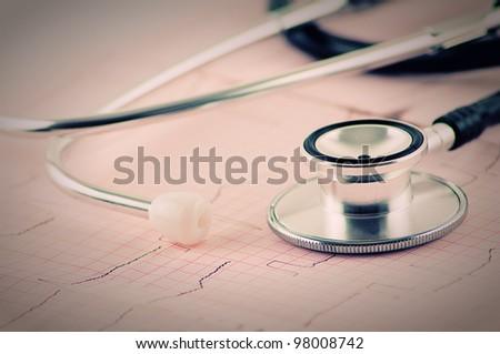medical stethoscope on electrocardiogram (ECG, EKG ) close up - stock photo