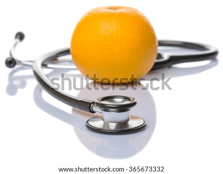 Medical stethoscope with an orange fruit over white background. Healthy lifestyle concept image. - stock photo