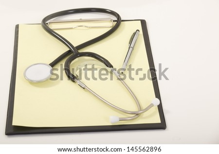 Medical Stethoscope with Pen on Medical File Folders - stock photo