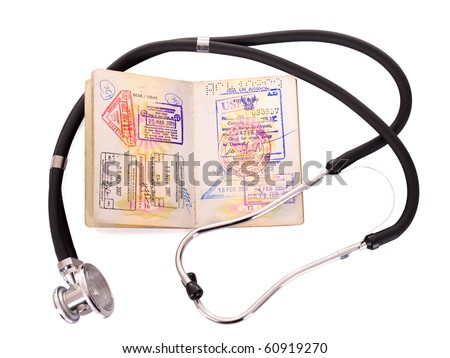 Medical still life with stethoscope and passport. Isolated.