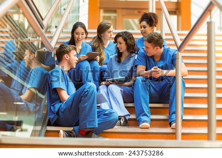 Medical students taking a break on the steps at the university - stock photo