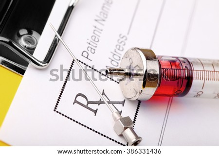 Medical syringe and prescription form of the drug. - stock photo
