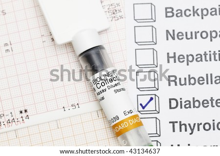 Medical Syringe with result - many uses in medical field. - stock photo