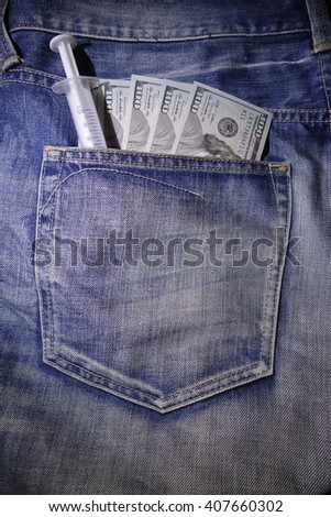 Medical syringes with US dollars in the jeans pocket - stock photo