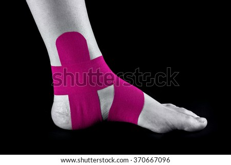 medical taping for ankle stabilization - stock photo