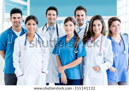 Medical team at the hospital looking very happy  - stock photo