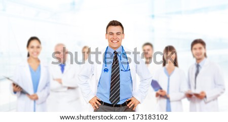 medical team doctor team happy smile with stethoscope, group of people in hospital - stock photo