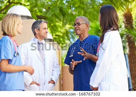 Medical Team Having Discussion Outdoors - stock photo