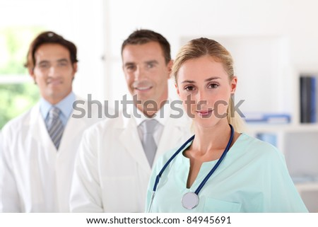 Medical team standing in clinic room