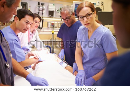 Medical Team Working On Patient In Emergency Room - stock photo
