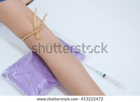 Medical technologist doing a blood draw - stock photo