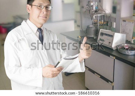 Medical technologist in the laboratory are satisfied. - stock photo