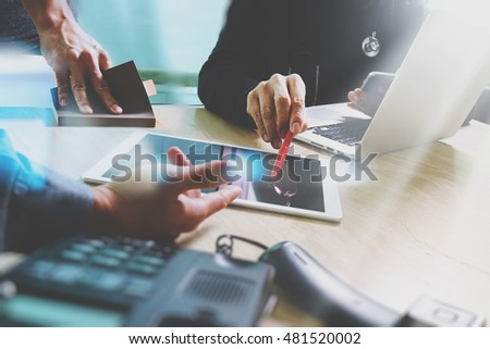 Medical technology network team meeting concept. Doctor hand working smart phone modern digital tablet laptop computer medical chart interface, compact server foreground