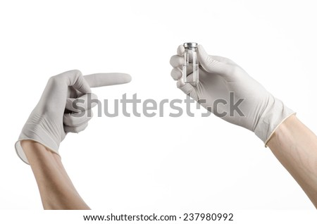 Medical theme: doctor's hand in a white glove holding a vial of clear liquid for injection isolated on white background - stock photo