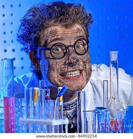Medical theme: funny crazy scientist is working in a laboratory. - stock photo
