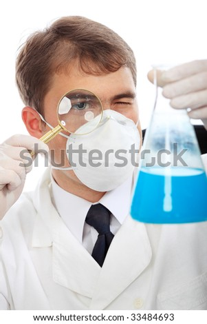 Medical theme: portrait of a curious doctor with magnifying glass.