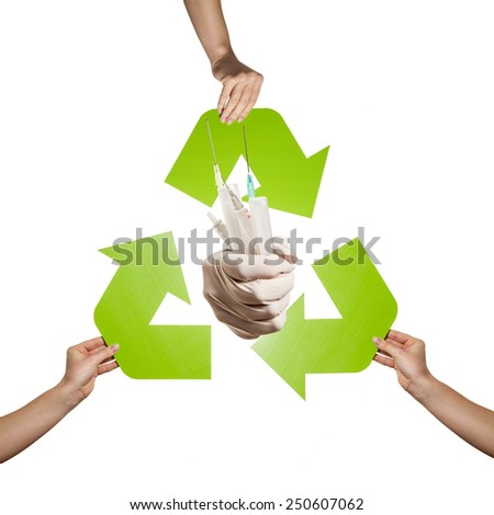 Medical waste recycling-  hands holding recycling sign and infective waste studio shot isolated on white background - stock photo