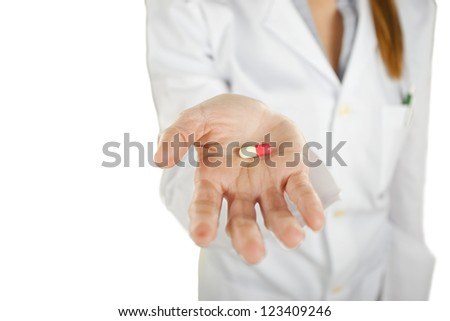Medical woman with pill in the hand. Young  woman with pill. isolated - stock photo