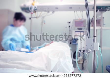 Medical work in intensive care ward - stock photo