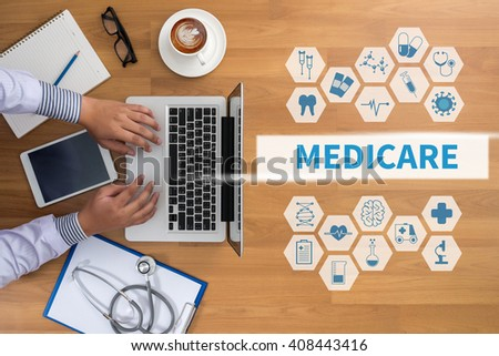 MEDICARE Professional doctor use computer and medical equipment all around, desktop top view, coffee - stock photo