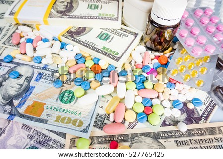 medication concept.  Medicine pills with money dollar. Cost of the healthy life