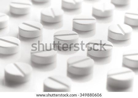 Medication Pills White Background. Pills in a row.