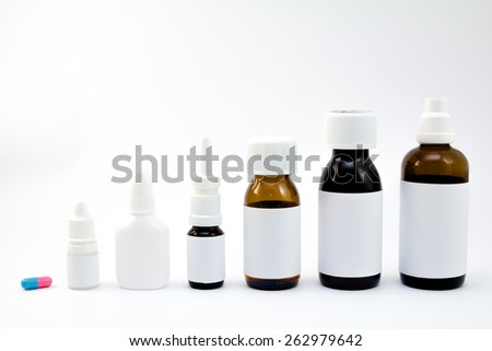 Medications in the bottles groupped and isolated on white
