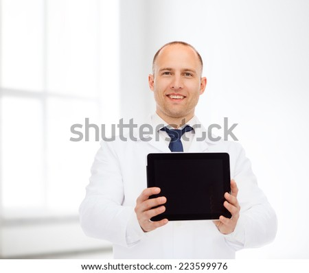 medicine, advertisement and workplace concept - smiling male doctor showing tablet pc computer screen over white room background - stock photo