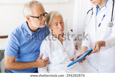 medicine, age, health care and people concept - senior woman, man and doctor with tablet pc computer at hospital ward - stock photo