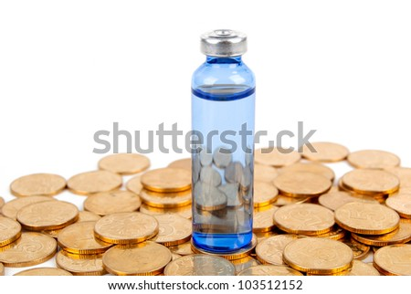 Medicine and coin on white background - stock photo