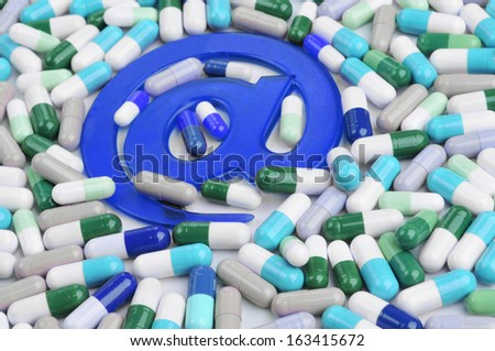 medicine and pharmacy by electronic and internet media from e-commerce. Pills and drugs with email symbol - stock photo