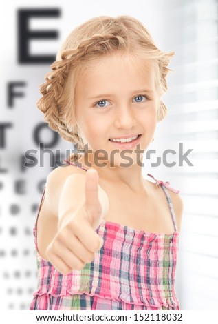 medicine and vision concept - girl with optical eye chart - stock photo