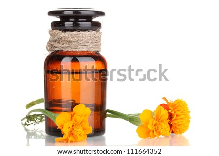 medicine bottle and flowers isolated on white - stock photo