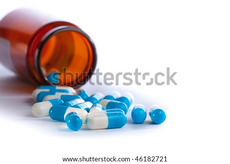 medicine bottle and pills