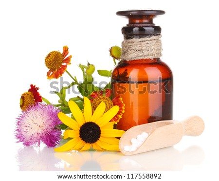 medicine bottle with tablets and flowers isolated on white - stock photo