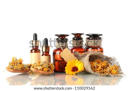 medicine bottles and calendula, isolated on white - stock photo