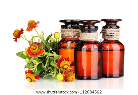 medicine bottles and flowers isolated on white
