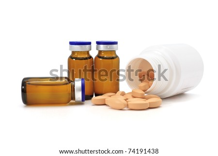 medicine bottles and pills over white background - stock photo