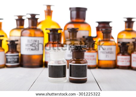 medicine bottles with blank labels on wooden table
